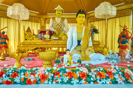 MANDALAY, MYANMAR - FEBRUARY 23, 2018: The sculptures of King Mindon and his wife, located in small pavilion on the territory of Kyauktawgyi Pagoda, on February 23 in Mandalay Editorial