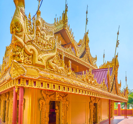 The beautiful gilden carved decorations of the shrine in Kyauktawgyi Pagoda complex, Mandalay, Myanmar