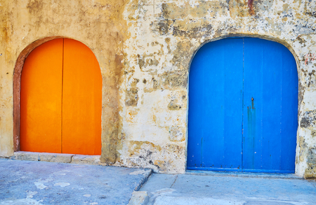The colorful wooden doors of boat houses in San Lawrenz fishing village, Gozo Island, Malta.