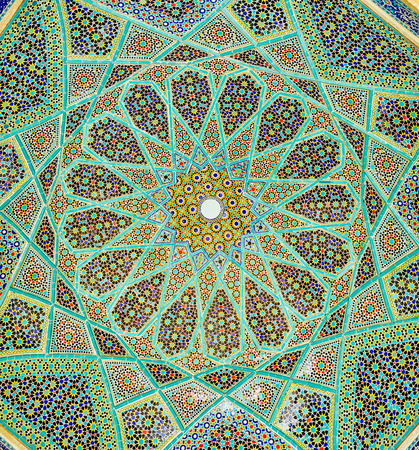 The close-up of intricate Persian mosaic patterns of dome of the open pavilion of Hafez Tomb, Shiraz, Iran.