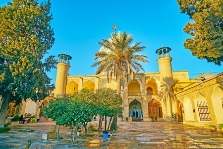 Visit Imamzadeh Ali Ibn Hamzeh Holy Shrine, famous for its traditional Persian architecture and ornate exterior decorations of brick, glazed tile, mosaic and carved wood, Shiraz, Iran.