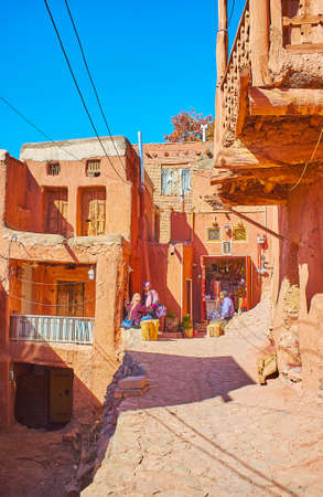 ABYANEH, IRAN - OCTOBER 23, 2017: The small food store and tourist cafe in backstreet, lined with ancient adobe houses, covered with red-ochre mud, on October 23 in Abyaneh