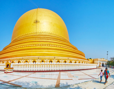 SAGAING, MYANMAR - FEBRUARY 21, 2018: Panorama of the main stupa of Yaza Mani Sula Kaunghmudaw Pagoda complex, surrounded by wide walking alley, on February 21 in Sagaing.