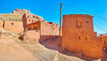 Observe preserved medieval architecture of Abyaneh - the clay village in Karkas mountains, located on the steep slope, Iran.