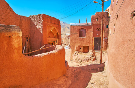 Get lost among the medieval reddish mud buildings of mountain Abyaneh village with preserved pieces of ancient architecture, Iran. 版權商用圖片