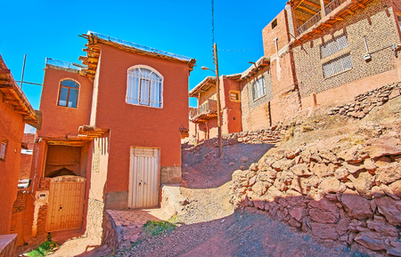 Walk the hilly streets of Abyaneh among historic red-ochre houses of oldest Iranian village.
