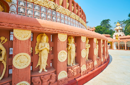 The decorative fence around the stupa of Sitagu International Buddhist Academy temple with statues of Nats (Spirits), Sagaing, Myanmar.