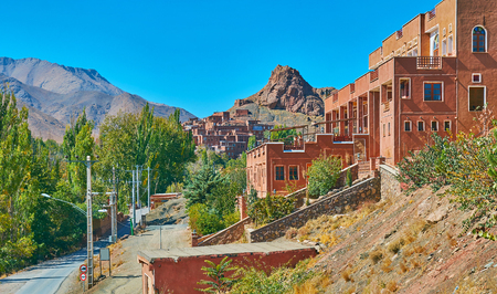 Observe the ancient Abyaneh village, located in Karkas mountains and famous for ochre adobe houses, Iran.
