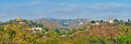 Panorama of medieval Sagaing, covered with deep forests, old pagodas and shrines tower the hills and rise through the greenery, Myanmar.