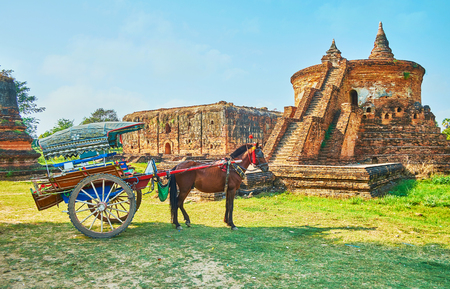 The horse-drawned cart at the ancient Myint Mo Taung temple and Wingaba Monastery, located in archaeological site among the agricultural lands of Ava (Inwa), Myanmar.