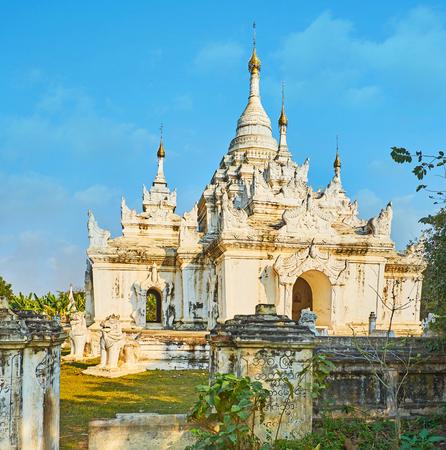Historic white Desada Taya Pagoda is the beautiful place to visit in ancient Royal City of Ava (Inwa), Myanmar.