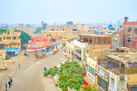 GIZA, EGYPT - DECEMBER 20, 2017: The residential neighborhood of Giza city with variety of cafes and hotels adjoins to the Necropolis, on December 20 in Giza