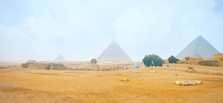 Panoramic view on Giza archaeological site with Pyramids and Great Sphinx on the middle, Egypt