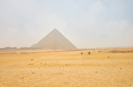 The typical winter weather  with mist shrouded pyramids of Giza complex, Egypt