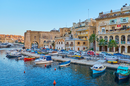 SENGLEA, MALTA - JUNE 18, 2018: Sheer Bastion - the medieval fortification of L-Isla faces Vittoriosa marina and looks great in sunset rays, on June 18 in Senglea.