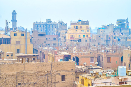 The aerial view on roofs of old edifices in islamic neighborhood of Cairo, Egypt