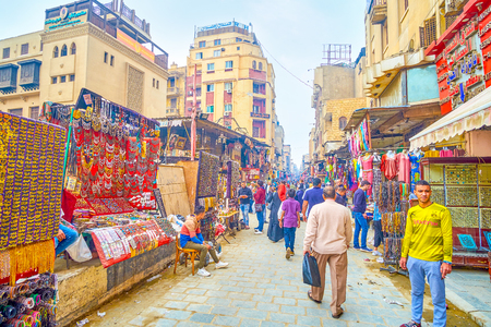 CAIRO, EGYPT - DECEMBER 20, 2017: The goldsmith district of Khan El-Khalili souq is the most beloved among tourist and local women due to high variety of Egyptian style bijouteries and jewelleries, on