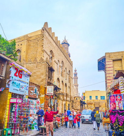 CAIRO, EGYPT - DECEMBER 20, 2017: The Al-Muizz is the central street of Islamic neighborhood with the biggest historical market in old town, on December 20 in Cairo.