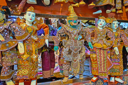 Traditional handmade string puppets of Nats (Burmese Spirits deities) and Tosakan devil king in authentic workshop of Shwe-gui-do Quarter, Mandalay, Myanmar.