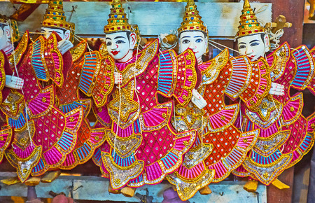 The beautiful Buddhist string puppets of Nats (Spirit deities) in workshop-store of Shwe-gui-do quarter, Mandalay, Myanmar.