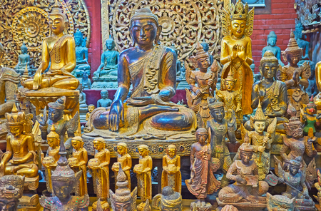 The wide range of scenic handmade Buddhist cult sculptures and statuettes in shape of Buddha, Nats (spirit deities), bhikkhu monks and mythic creatures in workshop of Shwe-gui-do quarter, Mandalay, Myanmar.