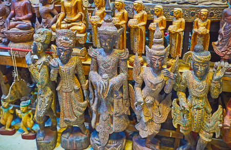 The sculptures of Nats (spirit deities) and bhikkhu monks are decorated with stone and glass inlay, Shwe-gui-do quarter, Mandalay, Myanmar.