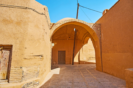 Explore historic city of Yazd - one of the oldest in world with maze of narrow curved streets, tall clay fences, numerous passageways (kuche), Iran.
