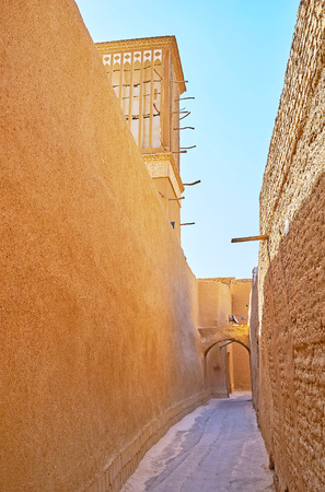 All the residential buildings in old neighborhoods of Yazd face the street with tall blank walls, also serving as the fences, protecting the courtyards from prying eyes, Iran.
