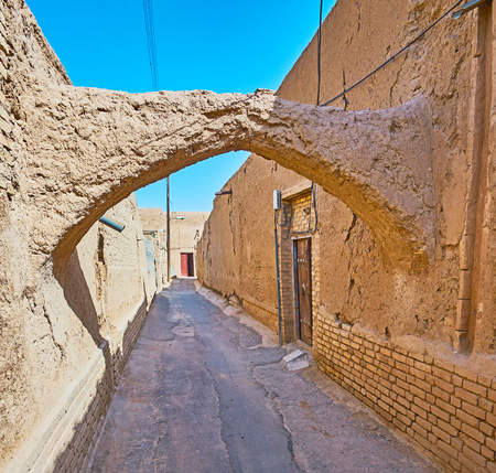 Yazd is the best place to feel the atmosphere of medieval Eastern desert city with preserved neighborhoods, blank walls of living edifices, kuche passageways and chaotic layout, Iran. Stock Photo