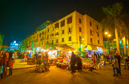 CAIRO, EGYPT - DECEMBER 20, 2017: Midan Hussein Square after dusk transforms into a huge market, and crowds of locals head there for shopping, on December 20 in Cairo.