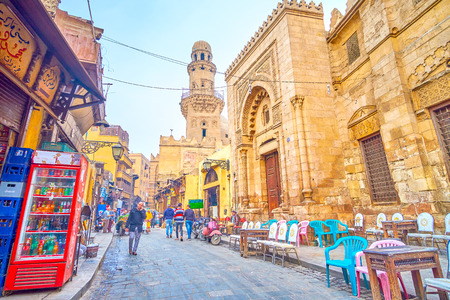 CAIRO, EGYPT - DECEMBER 20, 2017: El Gamaleya street is a fine example of real Egyptian life, with numerous medieval religion complexes, endless market and tea houses, stretch along the street, on December 20 in Cairo. Editorial