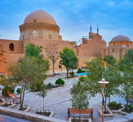 Enjoy the evening in garden at historic buildings of Alexander's Prison and Maghbareh-ye Davazdah Imam (Twelve Imams) Mausoleum, Yazd, Iran.