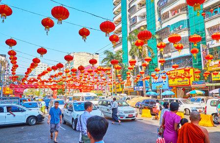 YANGON, MYANMAR - FEBRUARY 17, 2018: Feel holiday buzz and fuss in Maha Bandula Road of Chinatown (Tayoke Tan) on Chinese New Year celebration, on February 17 in Yangon.