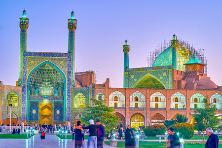 ISFAHAN, IRAN - OCTOBER 19, 2017: The beautiful evening illumination of colorful Shah Mosque, on October 19 in Isfahan Editorial