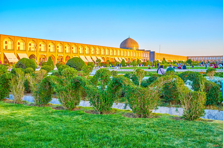 ISFAHAN, IRAN - OCTOBER 19, 2017: Central Naqsh-e Jahan Square nowadays is a huge park with numerous bushes and trees, is very popular among locals for picnics, on October 19 in Isfahan