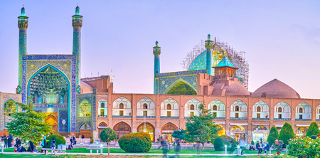 ISFAHAN, IRAN - OCTOBER 19, 2017: The beautiful Shah Mosque is imbedded into the covered trading gallery, surrounding Nashq-e Jahad Square, on October 19 in Isfahan