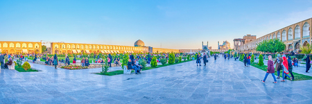 ISFAHAN, IRAN - OCTOBER 19, 2017: Panorama of Naqsh-e Jahan, the central and the biggest square in the city, and the best place to spend the evening, on October 19 in Isfahan