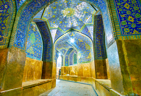 ISFAHAN, IRAN - OCTOBER 19, 2017: The corridors in Shah Mosque are decorated in general style with a whole complex, used the same decorative elements and same ornament, on October 19 in Isfahan