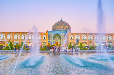 ISFAHAN, IRAN - OCTOBER 19, 2017:  The large pool with fountain on Nashq-e Jahad Sqaure is the main meeting place among youth in Isfahan, on October 19 in Isfahan Editorial