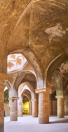 ISFAHAN, IRAN - OCTOBER 21, 2017: The cool and shady underground hypostyle hall is the Northern shabestan of Jameh Mosque, it was in use during the hot summer season, on October 21 in Isfahan.