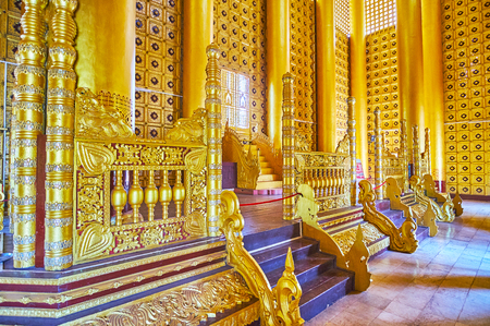 BAGO, MYANMAR - FEBRUARY 15, 2018: The Lion (Thihathana) Throne Hall of Kanbawzathadi Golden palace is decorated with intricate carved patterns, mirrorwork, ornate sculptures and gilding, on February 15 in Bago.