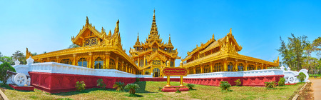 Panorama of exterior of Kanbawzathadi golden palace with gilded wooden pyatthat roof, scenic carvings and large windows, Bago, Myanmar.