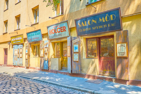 KRAKOW, POLAND - JUNE 21, 2018: The line of preserved historical store's facades are the remains of former Jewish trading life of Kazimierz district, on June 21 in Krakow