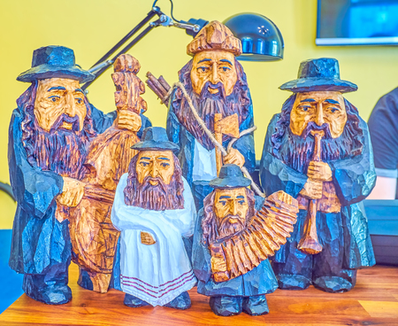 The beautiful wooden carved figurines of the Jewish music band, that play in different music instruments, Krakow, Poland