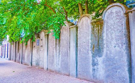 KRAKOW, POLAND - JUNE 21, 2018: The preserved fragment of the wall, surrounding Krakow Ghetto in Podgorze district, located in Lwowska street, on June 21 in Krakow.