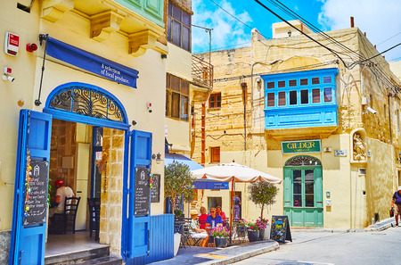 RABAT, MALTA - JUNE 16, 2018: Tourists enjoy the lunch in cozy cafes of old town, offering tasty Maltese cuisine and refreshing beverages with a view on historical mansions, on June 16 in Rabat.