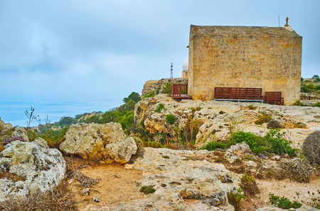 The medieval roadside chapel of St Mary Magdalene situated on the rocky shore at place, famous as Dingli Cliffs, Siggiewi, Malta.