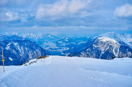 The snowshoe route to Five Fingers viewing platform with Alpine scenery of Inner Salzkammergut on the background, Austria.