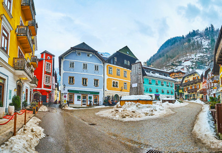 HALLSTATT, AUSTRIA - FEBRUARY 25, 2019: Market square (Marktplatz) boasts traditional architecture with brightly painted townhouses and ornate wooden carvings, on February 25 in Hallstatt. Redakční