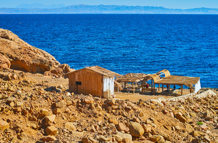 Old summer cafe, located on the rocky mountain slope on shore of Aqaba gulf in Dahab resort, Sinai, Egypt. 写真素材